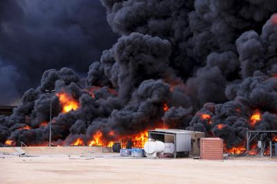 Smoke rises from burning oil storage tanks in the port of Ras Lanuf. (Reuters photo)